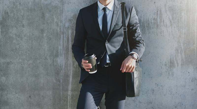 The modern manager with paper coffee cup
